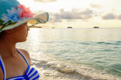 Girl on the beach at Similan Island, Thailand. Half portrait teenage girls in a blue swimsuit looking beautiful nature of sea during sunrise with happiness on Stock Image