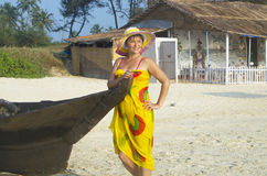 The girl on a beach smiles Royalty Free Stock Photos