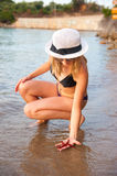 Girl at Beach with Starfish Royalty Free Stock Photography