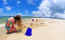 Girl on Beach With Storm Approaching Stock Photography