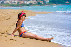 Girl on the beach in summer Stock Image