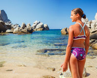 Girl on the beach. Summer vacation, lovely girl on the beach standing and looking at the sea Royalty Free Stock Photography