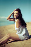Girl on a beach on the sun on an ocean coast Royalty Free Stock Photos