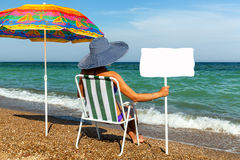 Girl on the beach, sunbathing, girl with a laptop, woman under a stock image