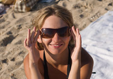 Girl on beach with sunglases Royalty Free Stock Images