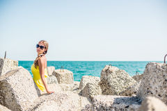 Girl on the beach at sunny day Stock Photo