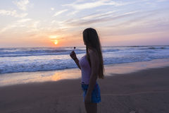 Girl Beach Sunrise Silhouetted Stock Image