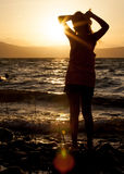 Girl at the beach at sunset  evening Stock Photography