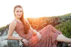 Girl beach sunset Stock Photos