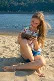 Girl on the beach with the tablet Stock Photography
