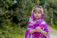 Girl at the beach 02. Girl in beach towel, little bit sad, praying posture Royalty Free Stock Photography