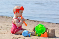 Girl with beach toys Stock Images