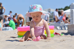 Girl on a beach with toys Stock Image