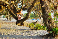 Girl on the beach tree Royalty Free Stock Images