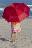 Girl at beach with umbrella. Stock Photography
