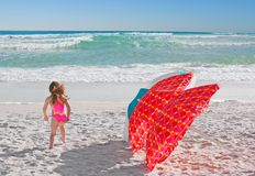 Girl and Beach Umbrellas Stock Images