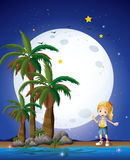 A girl at the beach under the bright fullmoon Stock Photography