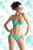 Girl in beach wear with sunglasses Royalty Free Stock Photo