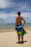 Girl at the beach. Wearing Brazilian flag in Porto Seguro, Brazil Royalty Free Stock Images
