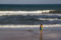 Girl at the beach. Wearing Brazilian flag in Salvador, Brazil Royalty Free Stock Photo