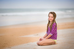 Girl at the beach. Girl with wet hair in purple bathing suit at the beach Royalty Free Stock Images