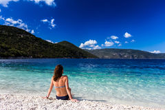 Girl on a beach. Woman in blue bikini resting on the beach Stock Images