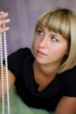 Girl with beads Stock Images