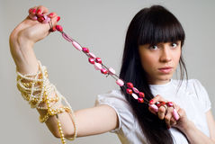 Girl with beads Royalty Free Stock Photo