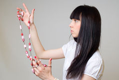 Girl with beads Royalty Free Stock Photography