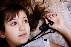 Girl with beads Stock Photos