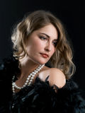 Girl with beads Stock Photos