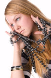 The girl with a beads. The girl with a beads isolated on a white background Royalty Free Stock Photography