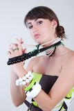 Girl with beads Royalty Free Stock Image