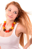 Girl with beads from tomatoes. Girl and beads from tomatoes stock image