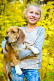 Girl with beagle Royalty Free Stock Images