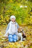 Girl with beagle Stock Image