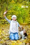 Girl with beagle Stock Photos