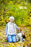 Girl with beagle Stock Photography