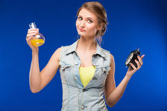 Girl with beaker and hours. Girl with beaker and an alarm clock in hands on a blue background stock image