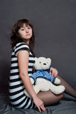Girl with bear Stock Images