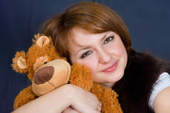 The girl with a bear Stock Images