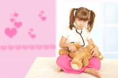 Girl and bear Royalty Free Stock Images