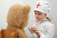 Girl with a bear Stock Images