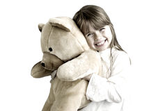 The girl with the bear. The girl is hugging big teddy bear Royalty Free Stock Photos