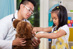 Girl with bear at doctor's office Royalty Free Stock Photo
