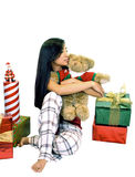 Girl With A Bear & Gifts. Girl sitting with a teddy bear and presents on a white background Stock Image