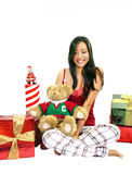 Girl With A Bear & Gifts. Girl sitting with a teddy bear and presents on a white background Royalty Free Stock Image