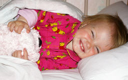 Girl with a bear is going to sleep Royalty Free Stock Photography