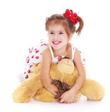 Girl with a bear Stock Image