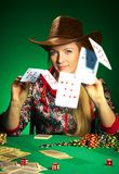 Girl with a beard plays poker Royalty Free Stock Photo